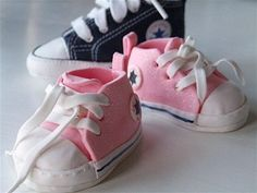 Pink minicoverse made of gumpaste - For a christeningcake I´m making for this weekend. My sons real blue converse in size 2 (18) in the back.  All you need to make them is avalible in my gallery. Have fun making them! :D