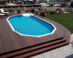 Here's a beautiful above ground pool deck with flowing steps.