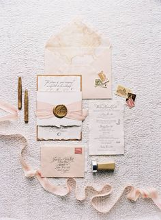 Dusty-pink invitation suite with a map envelope liner