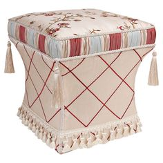 Accented with tassels, cord edging, and rouched trim, this pedestal-inspired ottoman brings a luxe touch to your living room seating group or master suite de...