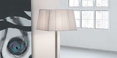 Martina 60 by Modiss is a series of contemporary lights that features a rectangular shades finished in silk ribbon. The Martina 60 floor hardware and frame are finished in satin nickel. An elegant design solution together with matching table and ceiling lights. Martina 60 is designed by Alfonso Fontal, 2003. For more information on this Floor Lamp visit the website.