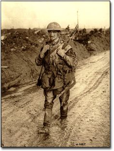 A Canadian soldier covered in mud returning from the front lines, [ca. 1918] Unknown photographer.