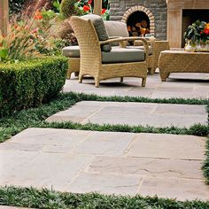 Backyard landscaping ideas can be as easy as adding pavers. Turn a garden path into a series of mini patios by using large islands of flagstone separated by ribbons of thick turf. In this backyard, the paved pieces have two functions: They act as a handsome and stable garden walkway, and they are large enough to handle outdoor seating when the family hosts a large party./