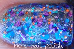 purple glitter base with purple, blue, and orange micro glitter, blue sapphire holo glitter, purple square glitter, and dark navy blue glitter, all in a clear lacquer base.