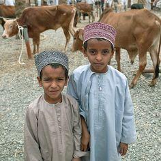 Omani kids in Nizwa catlle market - Oman