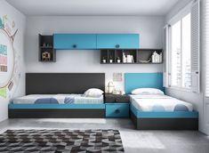 Dos canapés abatibles en ángulo y una mesita cubren la parte inferior del dormitorio juvenil por completo.