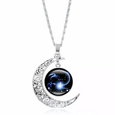 61e2b8d3e Capricorn zodiac sign constellation necklace features glass cabochon pendant  and crescent moon with silver chain.