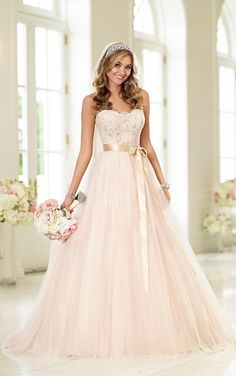 Lace and Tulle ball gown is constructed with a figure-flattering beaded bodice, sweetheart neckline, and a billowy soft Tulle skirt.