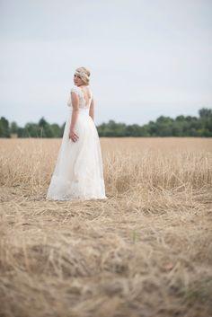 Mint gold and pink barn wedding near Salem, Oregon. Lace back dress bride in wheat field