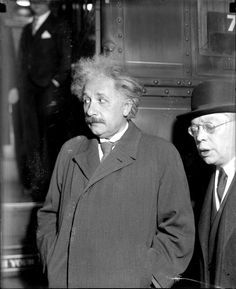 Albert Einstein and an unidentified man standing in front of a train in Photograph by Jun Fugita. Albert Einstien, Michael Faraday, Nobel Prize In Physics, Philosophy Of Science, Theoretical Physics, Theory Of Relativity, E Mc2, My Kind Of Town, Physicist
