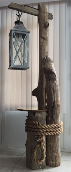 Ohio River driftwood, converted lantern, brass table top, and massive rope all…