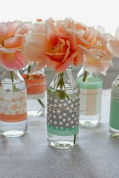 Glass bottle vases with scrapbook paper