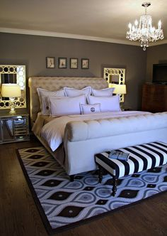 Placing mirrors behind twin night-table lamps will reflect light and help brighten a room. Good idea to incorporate, especially when choosing dark wall color.  Love the bed frame!!!