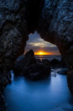 https://flic.kr/p/CrT12C | El Matador Cave | Decided to jump on the bandwagon and attempt this iconic shot at El Matador State Beach in Malibu, California. From what I hear, the sun only sets in this particular area for a few weeks out of the year. The dynamic range was much crazier here than I expected. I ended up having to manually blend 4 exposures in Photoshop to get the desired effect.