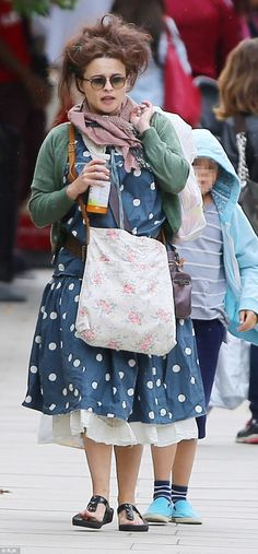 Odd bod: Helena was dressed in her usual quirky style as she strolled through North London with her son
