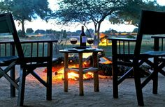 Satao Camp is an exclusive tented Camp in the mighty Tsavo East National Park, Satao Camp takes you back to the classical Out of Africa safari with green canvas tents, bush style showers and personal and friendly service; evoking a feeling of the true 'Old African' experience. Our location is indisputably unique; nestled beneath the shade of the old Tamarind trees, just in front of a very favored waterhole