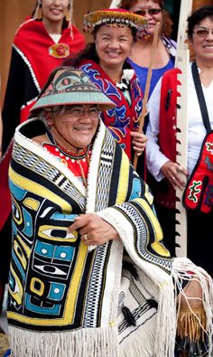 """Wayne Price wears the """"Diving Whale Lovebirds"""" Chilkat robe recently woven by Clarissa Rizal – June 2013"""