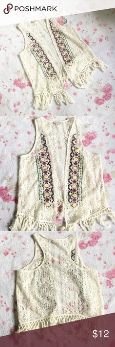 Lace Boho Fringe Vest 🌸An off white lace bohemian style best with fringe on the bottom 🌸 Adorned with bright tribal aztec embroidery on front 🌸 Size medium 🌸 Note: Only the vest is included in this listing Eyeshadow Jackets & Coats Vests