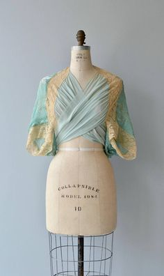 Fetching 1930s sea foam green wrap jacket/blouse with devoré silk velvet back, silk chiffon wrap front and lace shoulders. --- M E A S U R E M E N T S ---  fits like: fits multiple sizes as it basically just wraps around the body bust: 32-38 waist: ties to fit brand/maker: n/a condition: excellent  ➸ More tops & sweaters https://www.etsy.com/shop/DearGoldenVintage?section_id=5800171  ➸ Visit the shop http://www.DearGolden.etsy.com ________...
