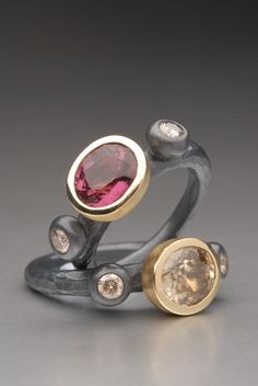 2 Oxidized silver and gold rings set with Tourmaline ,Zircon and cognac diamonds. Handmade by Malcolm Morris