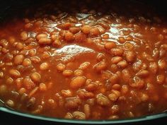 Copycat Ranch Style Beans 1 pound dried pinto beans 6 ounces tomato paste 1/2 cup chopped onions 1 clove minced garlic 1 tablespoon chili powder dash crushed red pepper flakes 1 teaspoon salt 1 teaspoon cumin 1/2 teaspoon dried marjoram 7 cups water