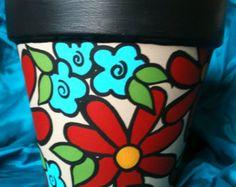 Pintadas en olla de barro con flores de fantasía de la