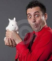 Image result for guy holding a rabbit in his mouth