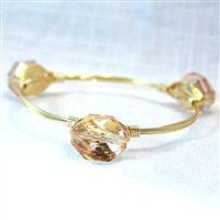 $28.99 Champagne colored iridescent stone on a gold wired bracelet http://piperlillies.com