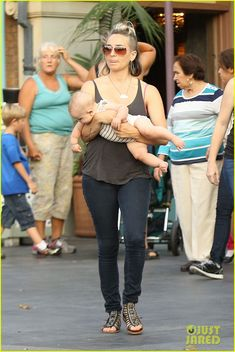 Cam Gigandet and his wife Dominique Geisendroff take their kids Everleigh and Rekker to Disneyland on July 1, 2013