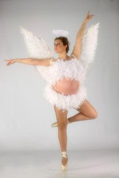 Pregnant meets ballet dancer meets angel wings.  Makes perfect sense.