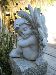 A wonderful center piece in any garden, resting on a stone or nestled among some flowers, this sweet resting angel is sure to bring tranquility to any outdoor space.  Color: Unpainted / natural stone