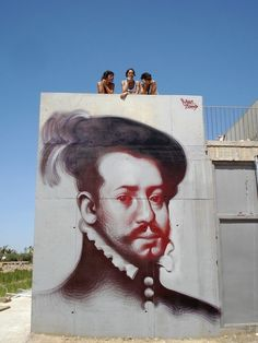 Incredible Urban Art Sside of building and visitors on the roof!!
