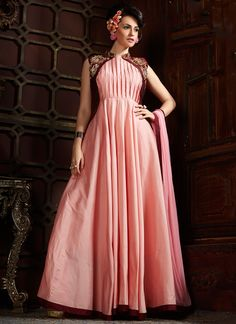 We unfurl our the intricacy and exclusivity of our creations highlighted in this kind of a lovely pink silk designer gown. The pretty embroidered and resham across the dress is awe inspiring