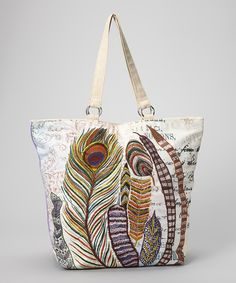 Rich embroidery and beautiful feathers embellish this one-of-a-kind textured tote. Featuring decadent shades and elegant detail, the haute handbag will add spark to the task of stowing essentials. Inside, a slip pocket organizes accoutrements with pizazz.19'' W x 14'' H x 2'' D9'' shoulder dropFabric