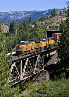 A westbound Union Pacific makes its way through the Sierra Mountains.