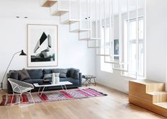 Suspended Staircase Floats Above Oslo Apartment