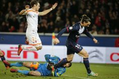 Paris Saint Germain's Zlatan Ibrahimovic (R) fights for the ball with Valenciennes' Nicolas Penneteau during their French Ligue 1 soccer mat...
