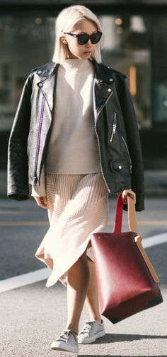 Cute fall outfit + oversized leather + knitwear + Vanessa Hong + cool androgynous vibes + pale pink knit skirt + sneakers combo  Jacket: Coach, Jumper/Skirt: THPLab, Shoes: Axel Arigato, Bag: Celine.