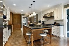 Kitchen Solvers - interesting paint color.  Don't like wood and wood, but white with wood nice.