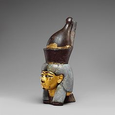 Attachment in the form of a head of a goddess wearing the double crown. Leaded bronze, gold, and electrum sheet on crown; Egyptian blue and glass inlays. Third Intermediate Period, c. 1070 - 664 B.C. | The Metropolitan Museum