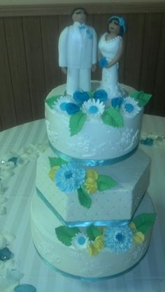 My daughter made the cakes and I made the topper and flowers!