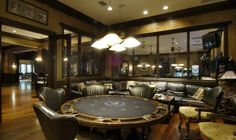 A perfect guys retreat!  A luxury poker room within a rec room!