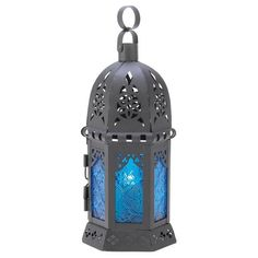 Like the deepest depths of the ocean, the azure blues of this candle lamp cast an enchanting aura of peace and tranquility. Simply place a votive inside to crea