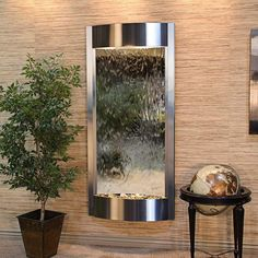 Elevate an entryway with this elegant presence of this black and silver indoor wall fountain. Pacifica Waters modern indoor wall fountain with light. Style # at Lamps Plus. Water Wall Fountain, Table Fountain, Indoor Wall Fountains, Indoor Fountain, Water Fountains, Indoor Water Features, Mirror Panels, Bronze Mirror, Water Walls