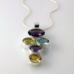 Sterling Silver Pendant with Oval Amethyst, Citrine and Topaz, Included in the price is a or Sterling Silver snake chain. Sterling Silver Pendants, Silver Jewelry, Silver Shop, Topaz, Amethyst, Rocks, Jewelry Design, Range, Drop Earrings