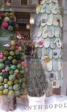 You've got to love Anthro's yarn ball and mitten Christmas trees!