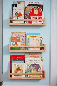 $3.99 IKEA spice racks as children's book storage shelves: http://www.ikea.com/us/en/catalog/products/40070185