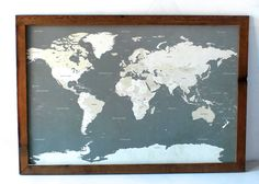 World Map I Push Pin Travel Map with Wood Frame on Etsy. I can't wait to buy this, beautify the frame and hang this in a hallway as the focal point of a collage of all my favorite travel photos!!