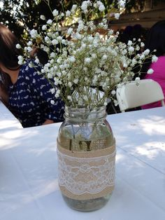 Lace & burlap mason jars with babies breath