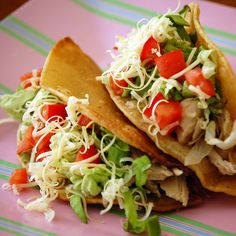 Slow Cooker Chicken Tacos  The slow cooker infuses the chicken with delicious flavor and spice in this easy taco recipe. Use budget-friendly chicken thighs for a great bargain and soft or baked taco shells to cut down on the fat.